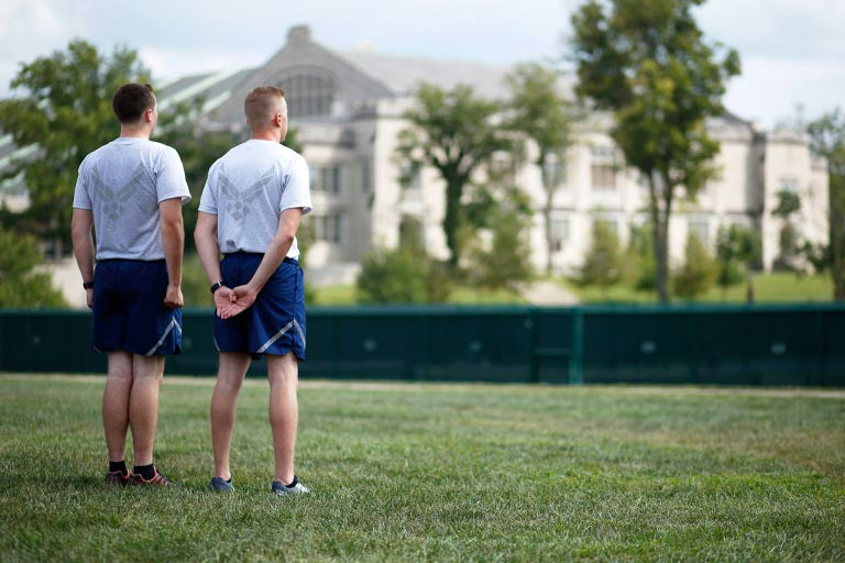 Two cadets stand at attention during leadership training at Dunn Meadow.
