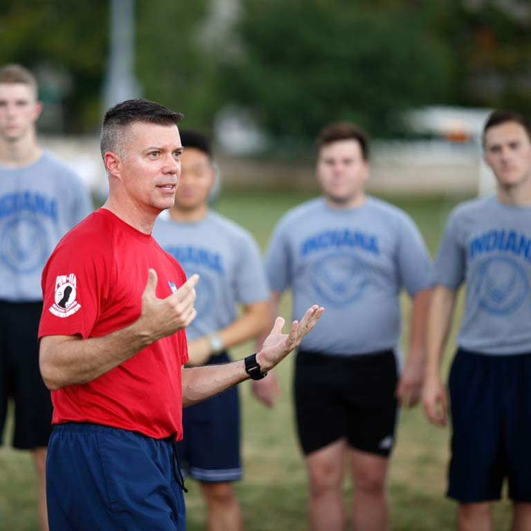 A member of the cadre addresses the cadets during leadership training exercises.