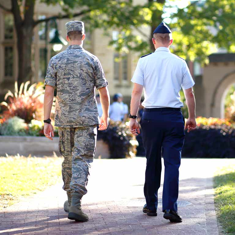 A cadet walks with a member of the cadre on the IU Bloomington campus.
